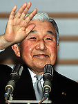 December 23, 2012, Tokyo, Japan - Emperor Akihito waves to a throng of well-wishers from behind the bullet-proof glass panel of the Imperial Palace balcony in Tokyo on Sunday, December 23, 2012. More than 20,000 well-wishers turned out to the palace, celebrating the 79th birthday of the monarch, who said in his statement that he's concerned about the country's aging population. (Photo by AFLO) UUK -mis-