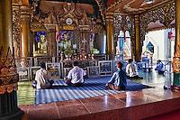 Myanmar, Burma, Yangon.  Sule Pagoda, Early Morning Worshipers.