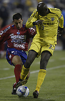 08 November 2006: CSD Municipal's Carlos Figueroa, left, and Columbus Crew's Ezra Hendrickson fight for a loose ball during the first half in Columbus, Ohio.<br />
