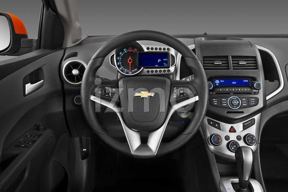 Steering wheel view of a 2013 Chevrolet Sonic LT 5 Door