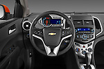 Steering wheel view of a 2013 Chevrolet Sonic LT 5 Door