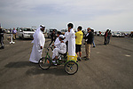 Local boys cycles around before the start of Stage 4 of the 2012 Tour of Qatar from Al Thakhira to Madinat Al Shamal, Qatar. 8th February 2012.<br /> (Photo Eoin Clarke/Newsfile)