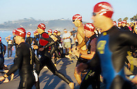 Triathalon competitors swimming