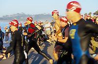 Triathalon competitors swimming