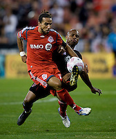Julius James (2) of D.C. United tries to clear the ball away from Dwayne De Rosario (14) of Toronto FC during the game at RFK Stadium in Washington, DC.  Toronto defeated D.C. United, 3-2.