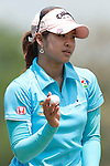 CHON BURI, THAILAND - FEBRUARY 19:  Pornanong Phatlum of Thailand acknowledges the the crowd on the 1st green during day three of the LPGA Thailand at Siam Country Club on February 19, 2011 in Chon Buri, Thailand.  Photo by Victor Fraile / The Power of Sport Images