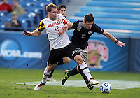 HOOVER, AL - DECEMBER 07, 2012:  Jereme Raley (12) of the University of Maryland tackles Jimmy Nealis (16) of Georgetown University during an NCAA 2012 Men's College Cup semi-final match, at Regions Park, in Hoover , AL, on Friday, December 07, 2012. The game ended in a 4-4 tie, Georgetown won on penalty kicks after overtime.