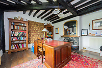 BNPS.co.uk (01202) 558833.<br /> Pic: Steve Elliott/Balfours/BNPS<br /> <br /> A striking 336-year-old Jacobean house that comes with its own vineyard is on the market for £1.25m.<br /> <br /> The grand Penarth House dates back to 1685 and has a host of period features including open fireplaces, ornate panelling and even a priest hole in one of the bedrooms.<br /> <br /> The Grade II* Listed six-bedroom house sits in eight acres of land on the banks of the River Severn near Newtown, Powys, in Mid-Wales.