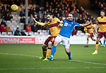 Motherwell v St Johnstone…..30.11.19   Fir Park   SPFL<br />Chris Kane's effort goes wide as Peter Hartley tackles<br />Picture by Graeme Hart.<br />Copyright Perthshire Picture Agency<br />Tel: 01738 623350  Mobile: 07990 594431