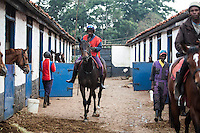 Horses and riders leave the yard of Patsy Sercombe for morning exercise at Ngong Racecourse, Nairobi, Kenya. March 13, 2013. Photo: Brendan Bannon