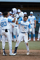 Angel Zarate (40) of the North Carolina Tar Heels celebrates at home plate after hitting a home run against the North Carolina State Wolfpack at Boshamer Stadium on March 27, 2021 in Chapel Hill, North Carolina. (Brian Westerholt/Four Seam Images)