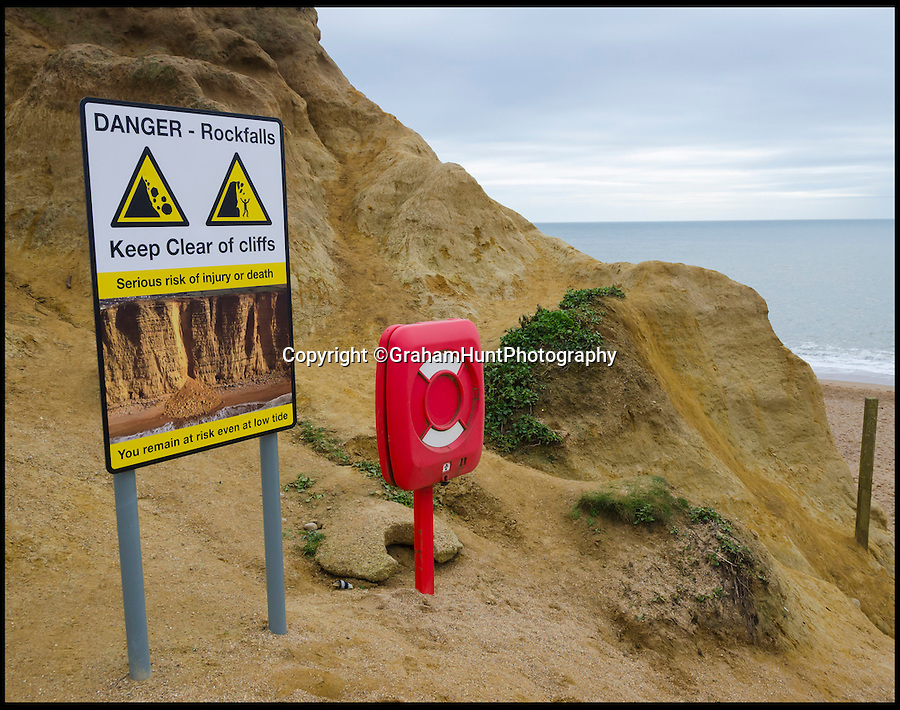 BNPS.co.uk (01202 558833)<br /> Pic: GrahamHunt/BNPS<br /> <br /> Holidaymakers risk their lives by posing for pictures on one of the rockfalls under the famous cliffs at West Bay in Dorset yesterday.<br /> <br /> The dangerous site, made famous by the TV crime drama Broadchurch, claimed the life of a holidaymaker in a rockfall in 2012, and there are many signs warning visitors to stay away from the base of the towering cliffs.<br /> <br /> Photographer Graham Hunt was shocked to see the group line up for the picture and said 'I couldn't believe my eyes, sudden rockfalls are common and they were risking their lives for a snap.'