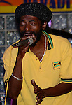 Buffalo Bill Reeves sings a reggae song during a performance in Runaway Bay, Jamaica. (DOUG WOJCIK MEDIA)