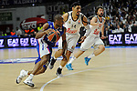 Real Madrid´s Gustavo Ayon and Sergio Llull and Anadolu Efes´s Dontaye Draper during 2014-15 Euroleague Basketball Playoffs match between Real Madrid and Anadolu Efes at Palacio de los Deportes stadium in Madrid, Spain. April 15, 2015. (ALTERPHOTOS/Luis Fernandez)