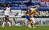 Bolton Wanderers' Antoni Sarcevic (top) competing with Mansfield Town's George Maris<br /> <br /> Photographer Andrew Kearns/CameraSport<br /> <br /> The EFL Sky Bet League Two - Bolton Wanderers v Mansfield Town - Tuesday 3rd November 2020 - University of Bolton Stadium - Bolton<br /> <br /> World Copyright © 2020 CameraSport. All rights reserved. 43 Linden Ave. Countesthorpe. Leicester. England. LE8 5PG - Tel: +44 (0) 116 277 4147 - admin@camerasport.com - www.camerasport.com
