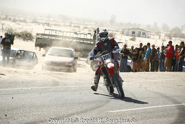 MAN on BIKE COMPETES THROUGH DESERT DURING TECATE's ANNUAL 250 SCORE OFF-ROAD RACE BICYCLE RACE