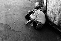 Teheran, Iran, April 12, 2007.A beggar sleeps on the sidewalk near the Teheran bazar..
