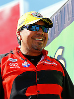 Jun. 1, 2014; Englishtown, NJ, USA; NHRA funny car driver Cruz Pedregon celebrates after winning the Summernationals at Raceway Park. Mandatory Credit: Mark J. Rebilas-