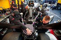 Oct 4, 2020; Madison, Illinois, USA; Crew members work on the dragster of NHRA top fuel driver Shawn Langdon in the pits during the Midwest Nationals at World Wide Technology Raceway. Mandatory Credit: Mark J. Rebilas-USA TODAY Sports