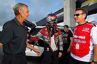 Aug 31, 2014; Clermont, IN, USA; NHRA funny car driver Bob Tasca III (center) and father Bob Tasca Jr (right) greet former pro stock driver Bob Glidden during qualifying for the US Nationals at Lucas Oil Raceway. Mandatory Credit: Mark J. Rebilas-USA TODAY Sports