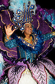 Rio de Janeiro, Brazil. Carnival; a woman in a very ornate gown and headdress on a float in the parade