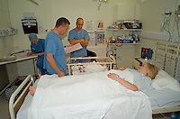 Newly born infant being handed to his mother after caesarean section birth..©shoutpictures.com.This image may only be used to portray the subject in a positive manner.john@shoutpictures.com