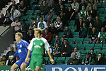 Hibernian 4, Peterhead 0, 22/08/2006. Easter Road Stadium, Scottish League Cup. Premier League side Hibernian (green) take on Division Two newcomers Peterhead  in the CIS Insurance (League) Cup second round tie at Easter Road. The home team won the tie 4-0. The stadium has been completely redeveloped in the last 10 years and average attendances have climbed in that period. Hibs were formed in 1875 and traditionally drew their support from Catholics and people in the port of Leith, although the ground is in Edinburgh. Picture shows Hibs fans in the main stand watching the action. Photo by Colin McPherson.