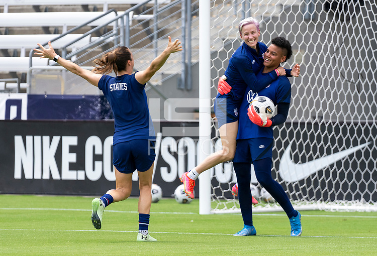 HOUSTON, TX - JUNE 9: Kelley O'Hara #5, Megan Rapinoe #15 and Adrianna Franch #21 of the USWNT celebrate during a training session at BBVA Stadium on June 9, 2021 in Houston, Texas.