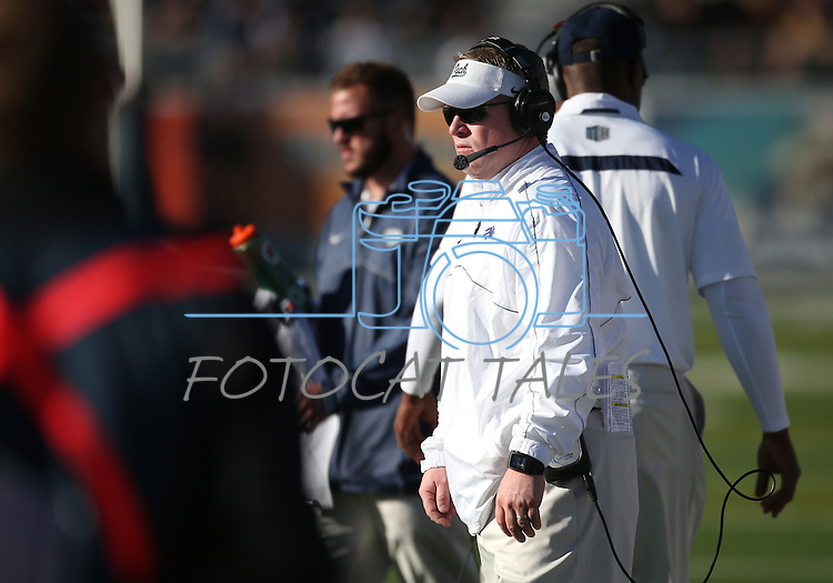 Nevada Head Coach Brian Polian works the sidelines during an NCAA college football game against BYU, in Reno, Nev., on Saturday, Nov. 30, 2013. (AP Photo/Cathleen Allison)