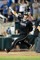 Mississippi State Bulldogs catcher Dustin Skelton (8) celebrates scoring the winning run during Game 4 of the NCAA College World Series against the Auburn Tigers on June 16, 2019 at TD Ameritrade Park in Omaha, Nebraska. Mississippi State defeated Auburn 5-4. (Andrew Woolley/Four Seam Images)