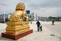 A large lion statue stands outside of the Geely Automobiles Factory in Taizhou, Zhejiang Province, China. Along with other auto makers in China, Geely is now looking overseas to sell its vehicles as stock increases and domestic margine declines. China is currently the world's 4th largest auto maker, plans to boost vehicle and automobile components exports by 15 folds to more than 120 billion yuan (15 billion US) in the next 10 years..