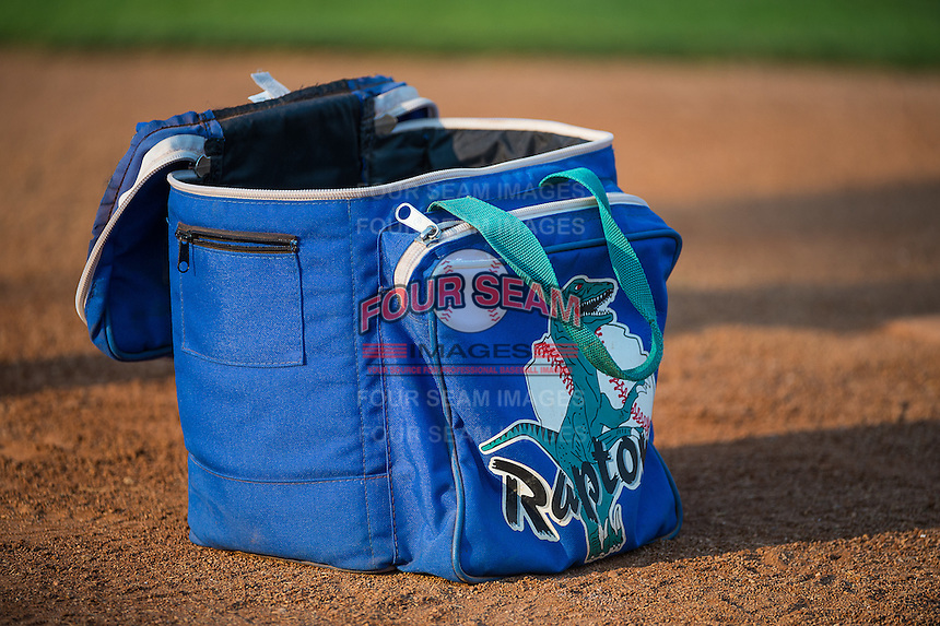 A Ogden Raptors ball bag sits on the field before the game against the Helena Brewers in Pioneer League action at Lindquist Field on August 19, 2015 in Ogden, Utah.  Ogden defeated Helena 4-2. (Stephen Smith/Four Seam Images)