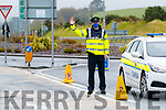 Garda Alan Clerkin on duty at a checkpoint near Castleisland on Wednesday.