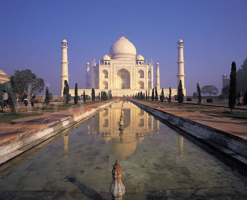 Classic early-morning view of the Taj Mahal reflecting in still water; Agra, Indi