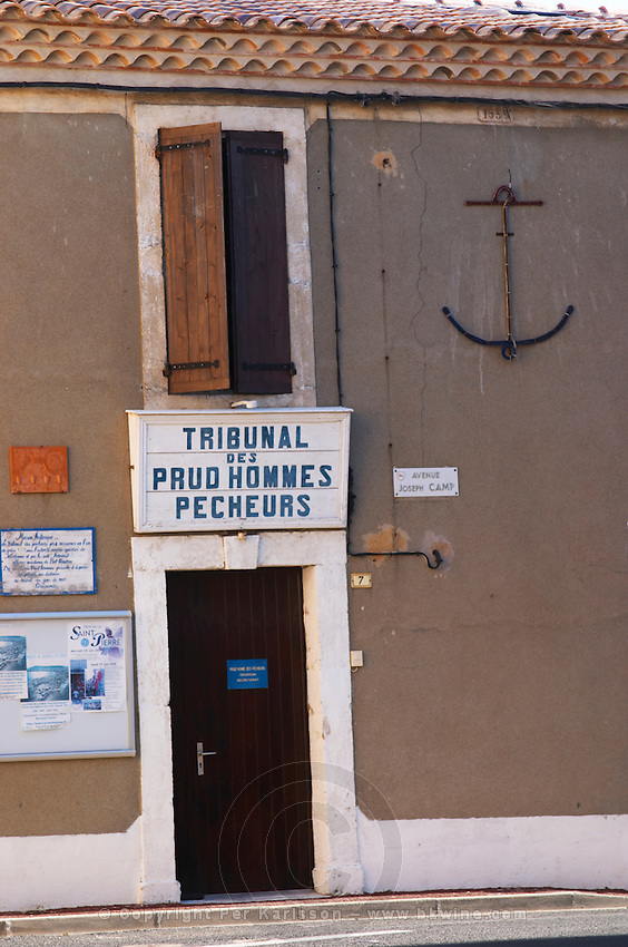 Gruissan village. La Clape. Languedoc. A door. Window. Tribunal des Prud'hommes Pecheurs - the court of prudhommes, work law, for fishermen. France. Europe.
