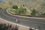 Woman bike rider, Lookout Mountain Road, Golden, Colorado, USA. .  John offers private photo tours in Denver, Boulder and throughout Colorado. Year-round.