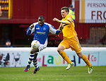 Motherwell v St Johnstone.....20.01.13      SPL.Shaun Hutchinson gets back to deny Gregory Tade.Picture by Graeme Hart..Copyright Perthshire Picture Agency.Tel: 01738 623350  Mobile: 07990 594431