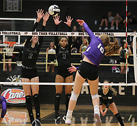 Madeline Lafata (16) of Fayetteville spikes against Victoria Otter (2) and Trinity Hamilton (3) of Bentonville on Thursday, Oct.  7, 2021, during play at Tiger Arena in Bentonville. Visit nwaonline.com/211008Daily/ for today's photo gallery.<br /> (Special to the NWA Democrat-Gazette/David Beach)