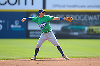 Hartford Yard Goats second baseman Matt McLaughlin (12) throws to first base during a game against the Somerset Patriots on September 12, 2021 at TD Bank Ballpark in Bridgewater, New Jersey.  (Mike Janes/Four Seam Images)