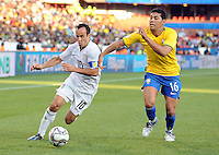 Landon Donovan (10) of USA and Andre Santos (16) of Brazil. Brazil defeated USA 3-0 during the FIFA Confederations Cup at Loftus Versfeld Stadium in Tshwane/Pretoria, South Africa on June 18, 2009.