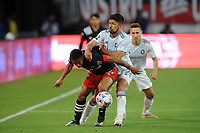 WASHINGTON, DC - MAY 13: Andy Najar #14 of D.C. United battles for the ball with Mauricio Pineda #22 of Chicago Fire FC during a game between Chicago Fire FC and D.C. United at Audi FIeld on May 13, 2021 in Washington, DC.