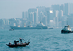 Chinese traditional fishing boat Hong Kong Island from Kowloon side. Shipping Modern high rise skyscrapers China 1990s 1991