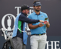 13th July 2021; The Royal St. George's Golf Club, Sandwich, Kent, England; The 149th Open Golf Championship, practice day; Antoine Rozner (FRA) consults his caddie on the first tee