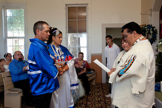 Native American bride and groom  during their wedding ceremony inside the Williamson River Indian Mission church located in Chiloquin Oregon