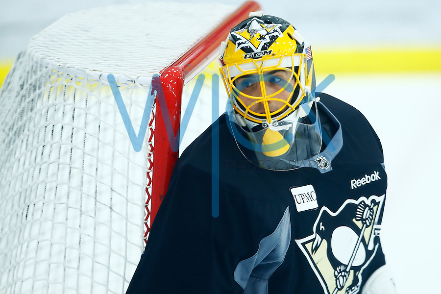 Marc-Andre Fleury #29 of the Pittsburgh Penguins stands in goal during practice at the Lemieux Sports Complex in Cranberry Township, PA on April 11, 2016. (Photo by Jared Wickerham / DKPS)