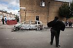 © Joel Goodman - 07973 332324 . 07/08/2011 . London , UK . A burned out car on Pembury Road in Tottenham . Overnight rioting and looting in Tottenham , following a protest against the police shooting of Mark Duggan . Photo credit : Joel Goodman