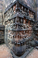 Sandstone bas relief of male figures, Devatas & Nagas of the underworld on the hidden wall at the Leper King Terrace, part of the Royal Square of Angkor Thom  - Angkor Wat, Siem Reap, Cambodia...