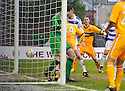MOTHERWELL'S TOM HATELEY'S CORNER KICK DROPS INTO THE NET FOR MOTHERWELL'S FIRST GOAL