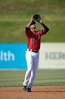 Kannapolis Intimidators shortstop Johan Cruz (13) settles under a pop fly during the game against the Delmarva Shorebirds at Kannapolis Intimidators Stadium on May 19, 2019 in Kannapolis, North Carolina. The Shorebirds defeated the Intimidators 9-3. (Brian Westerholt/Four Seam Images)