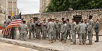 Military graduation ceremony along the wall surrounding the old Texas Alamo.
